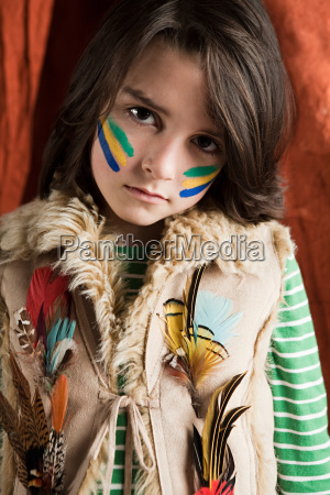 young boy dressed up in native