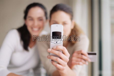 women with mobile phone and credit