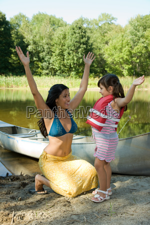mother and daughter by rowboat with