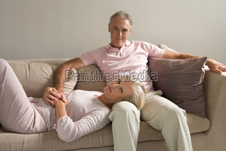 woman lying in mans lap
