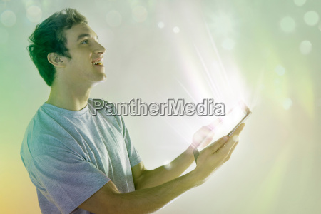 young man looking at light coming