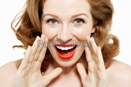 woman shouting with hands by mouth