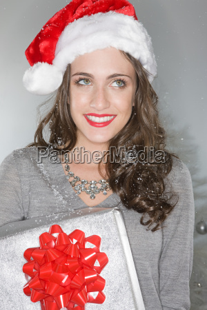 young woman wearing a santa hat