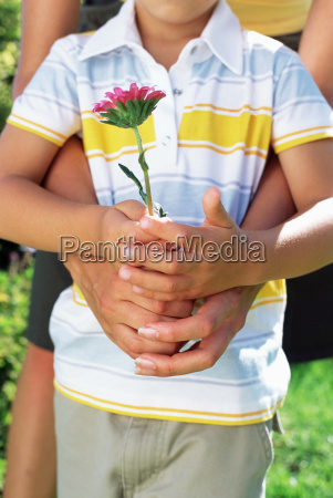mother and son holding flower