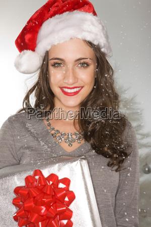 smiling woman wearing a santa hat