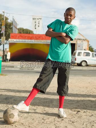 teenage african boy with football
