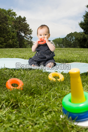 baby boy in park with toy