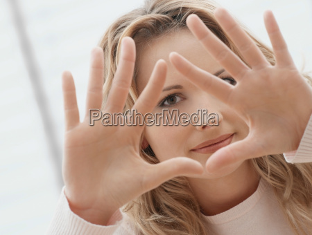 woman making triangle shape with her