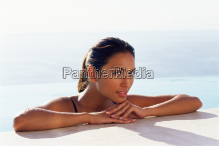 woman resting on the edge of