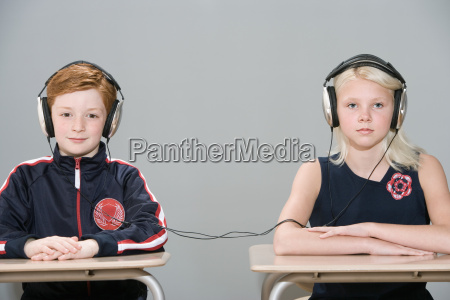 boy and girl with connected headphones