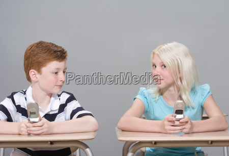 boy and girl with mobile phones