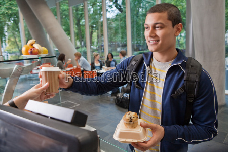 university student paying in college cafe