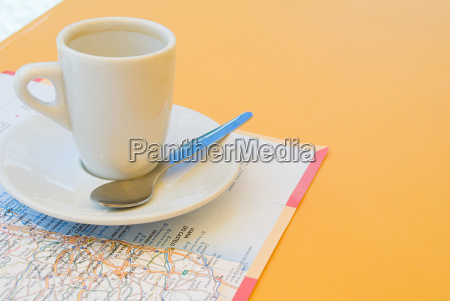 coffee cup and map