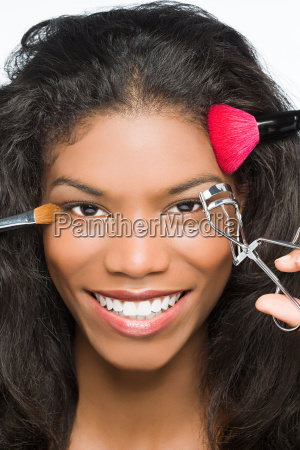woman having makeup done