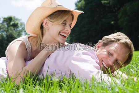 couple lying in field