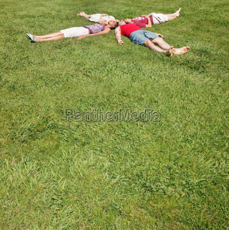 friends lying on the grass