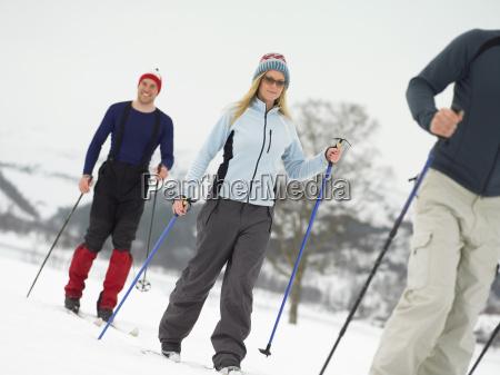 friends walking on skis