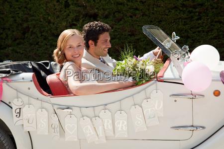 newlyweds leaving for honeymoon in vintage