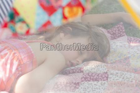 young girl sleeping in summer netting