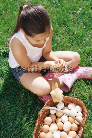 girl holding a chick