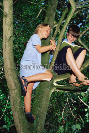 girl watching boy reading in a