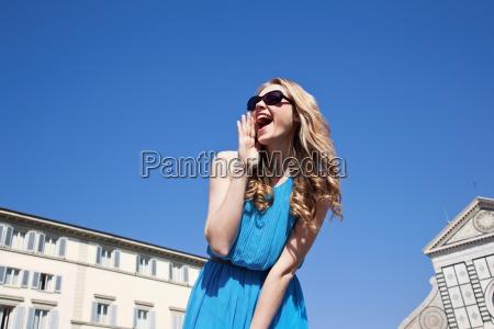 young woman shouting outdoors