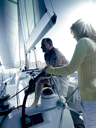 couple sailing a yacht