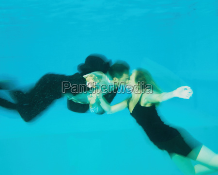 a couple kissing in a swimming