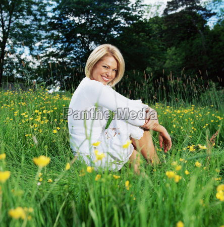 woman sitting in field