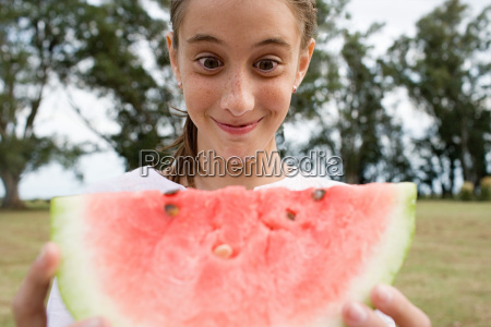 girl holding a large slice of