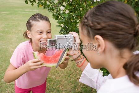 girl posing for a photograph