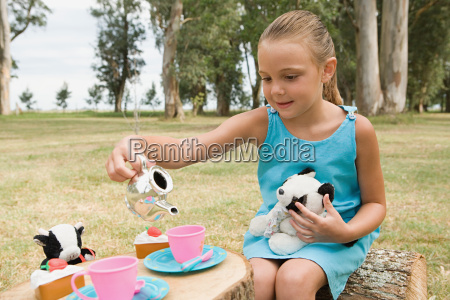 girl having a tea party with
