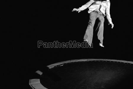 man jumping on trampoline