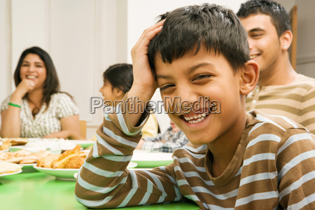 smiling boy at dining table