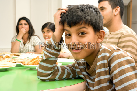boy with family at dining table