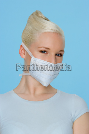 young woman wearing a surgical mask
