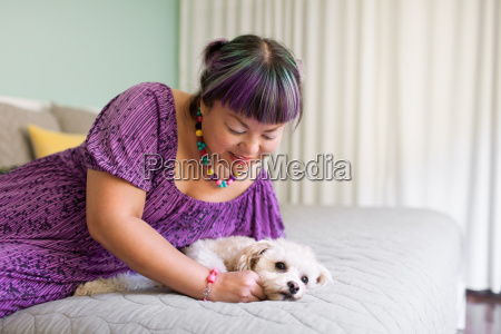 mid adult woman lying on bed