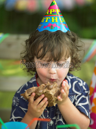 boy enjoying birthday cake