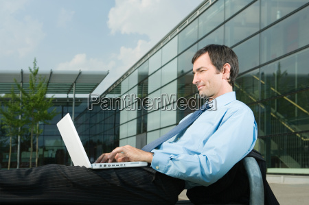 businessman with laptop on office court