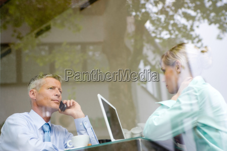 business couple working at bar table