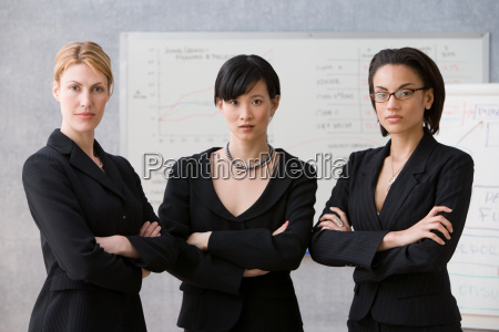 three young women in lecture theatre