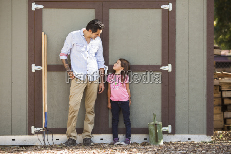 girl looking at father in front
