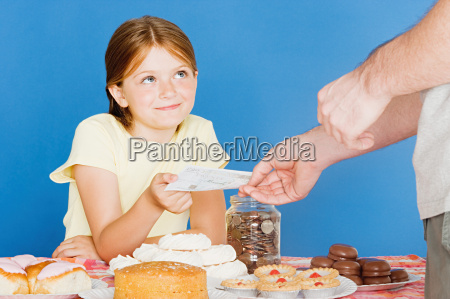 man buying cake from girl