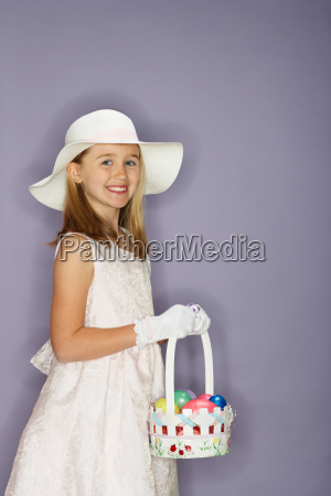 girl holding a bunch of easter