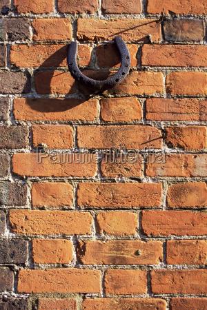 horseshoe mounted on brick wall