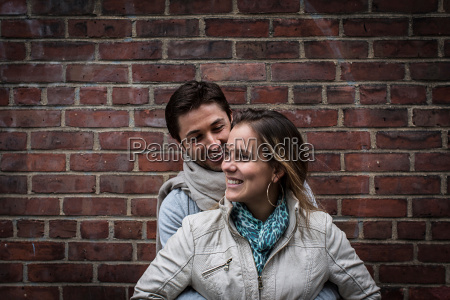 portrait of smiling couple in front