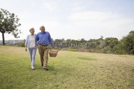 senior couple walking arm in arm