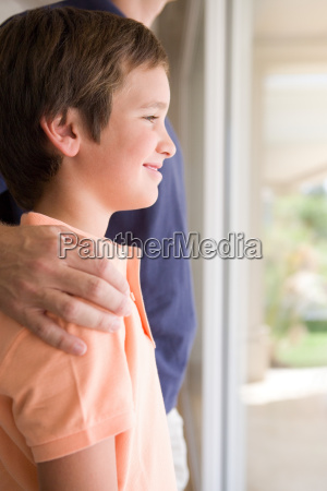 boy with fathers hand on his
