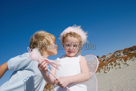 girl wearing costume with boy on
