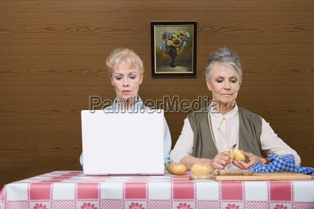 senior women with laptop and potatoes
